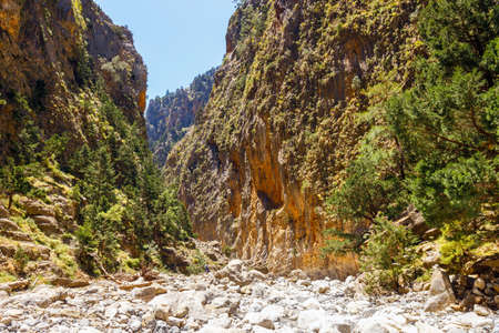 trecking: Tourists hike in Samaria Gorge in central Crete, Greece. The national park is a UNESCO Biosphere Reserve since 1981 Stock Photo