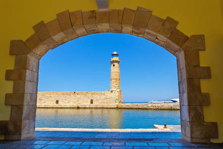 rethymno: old port and Lighthouse in Rethymno, Crete, Greece Stock Photo