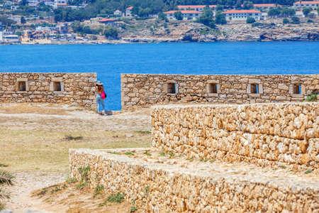 fortezza: Rethymno, Crete - 27 Maj, 2016 : Unidentified people visit Venetian fortress Fortezza in Rethymno, Greece