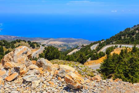 chora: curvy road near Chora Sfakion town on Crete, Greece