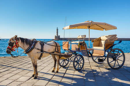 atraction: Horse carriage for transporting tourists in old port of Chania on Crete, Greece