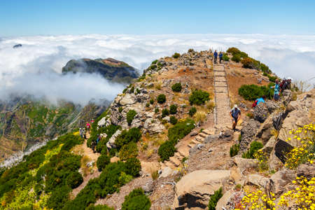 Madeira, Portugal 02 JULY, 2016: Unidentified people hiking on Pico Ruivo summit in central Madeira, Portugal