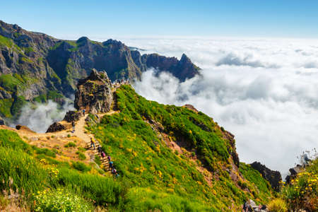 Madeira, Portugal 02 JULY, 2016: Unidentified people hiking on Pico do Areeiro summit in central Madeira, Portugal