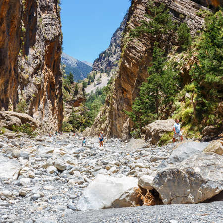 trecking: Samaria Gorge, Greece - MAY 26, 2016: Tourists hike in Samaria Gorge in central Crete, Greece. The national park is a UNESCO Biosphere Reserve since 1981