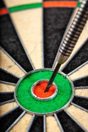 dart in bulls eye, close up Stock Photo