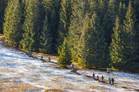 giewont: Tatra Mountains, Poland - January 30, 2016: Tourists strolling on a sunny day  in Tatra Mountains, Poland