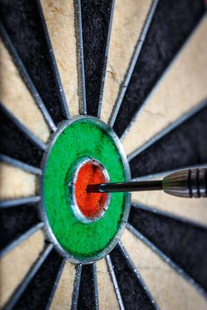 bull's eye: dart in bulls eye, close up Stock Photo