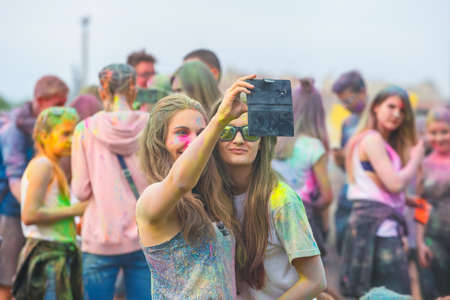 Krakow, Poland, 11 June, 2016: Festival of Colors in Krakow. Unidentified people dancing and celebrating during the color throw, Poland