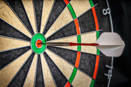 bull's eye: the  darts in bulls eye, close up Stock Photo