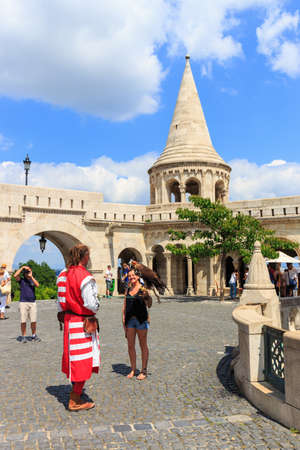 stephen: BUDAPEST, HUNGARY - July 24, 2014: Tourists on the Trinity Square near Fishermans Bastion in Budapest, Hungary Editorial