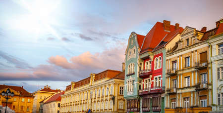 case colorate: Colorful houses in Timisoara at sunset, Romania Editoriali