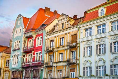 Colorful houses in Timisoara at sunset, Romania Stock Photo