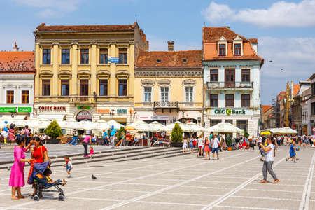 brasov: BRASOV, ROMANIA - 15 JULY, 2014: The main square of the medieval city of Brasov, main touristic city of Transylvania, Romania.