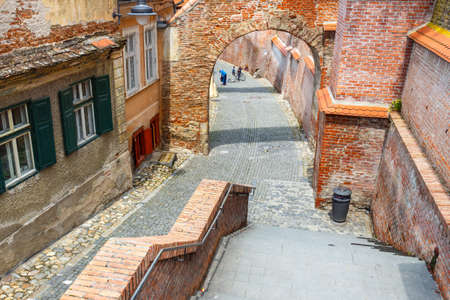 stroll: Sibiu, Romania - July 19, 2014: Old Town Square in the historical center of Sibiu was built in the 14th century, Romania