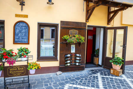 BRASOV, ROMANIA - 15 JULY, 2014: Winery, shop with Romanian wines in the medieval city of Brasov, main touristic city of Transylvania, Romania.