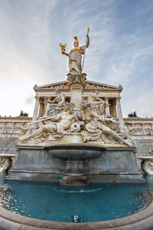 facade of austrian parliament building with Pallas Athena fountain in Vienna, Austria