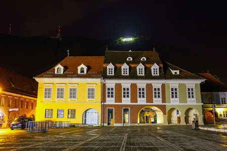 BRASOV, ROMANIA - JULY 19: Night view of Council Square on July 15, 2014 in Brasov, Romania. Brasov is known for its Old Town, which is a major tourist attraction