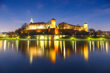 wawel: Wawel Castle in the evening in Krakow with reflection in the river, Poland. Long time exposure