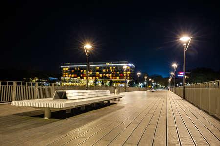 Kolobrzeg, Poland - Concrete pier in Kolobrzeg at night. Long time exposure