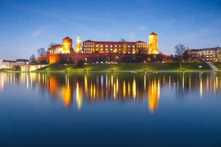 Wawel Castle in the evening in Krakow with reflection in the river, Poland. Long time exposure