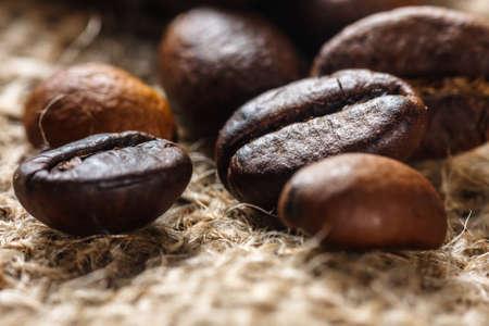 Coffee on grunge burlap background, close up Stock Photo