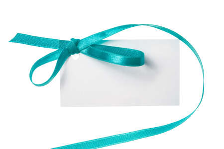 soft sell: Blank gift tag tied with a bow of green satin ribbon Stock Photo