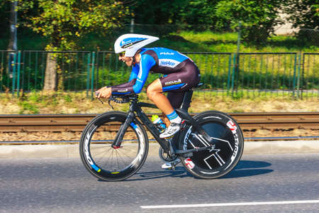 KRAKOW, POLAND - AUGUST 3, 2013: Unidentified participant of 70th Tour de Pologne cycling 7th stage race in Krakow, Poland. Tour de Pologne is the biggest cycling event in Eastern Europe.