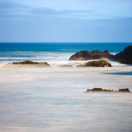 Los Hervideros, volcanic coastline with wavy ocean and blue sky, Long time exposure
