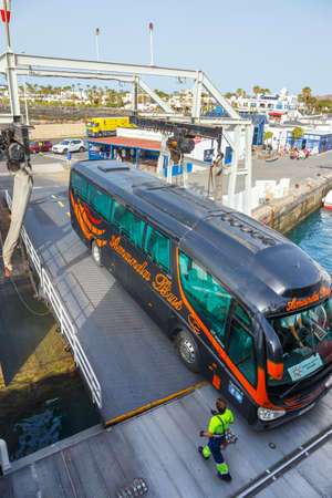 Playa Blanca, Lanzarote, 01 April, 2017: Top view of vehicle and passenger ferry.  The ferry runs several times a day between Lanzarote and Fuerteventura Island