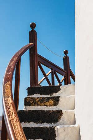 Windmill on blue sky background in cactus garden, Guatiza village, Lanzarote, Canary islands