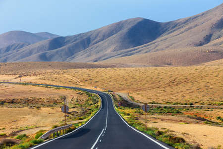 Road in the mountains of Betancuria in the southern part of the Canary island Fuerteventura, Spain Stock Photo