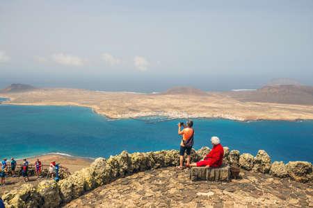 Mirador del Rio, Lanzarote, March 31, 2017: People enjoing Impressive view from Mirador del Rio to island of La Graciosa, Lanzarote, Canary islands