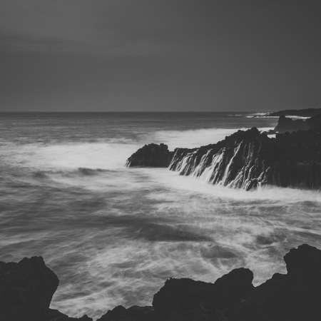 Long exposure shot of coast at Lanzarote, Los Hervideros, Black and white photo Stock Photo