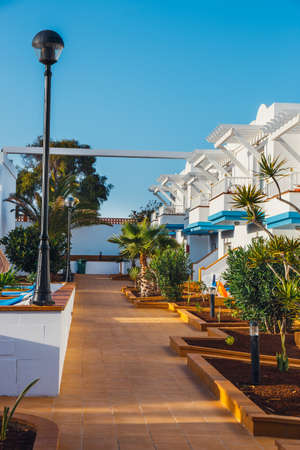 lodgings: Corralejo, Fuerteventura, Spain, April 03, 2017: Complex of hotel buildings and swimming pool in Arena Hotel in Corralejo, Spain