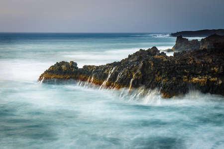 Long exposure shot of coast at Lanzarote, Los Hervideros, Spain Stock Photo