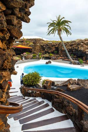 cavern: Lanzarote, Spain - March 29, 2017: People visiting volcanic cave in Jameos del Agua, Lanzarote, Canary Islands, Spain Editorial