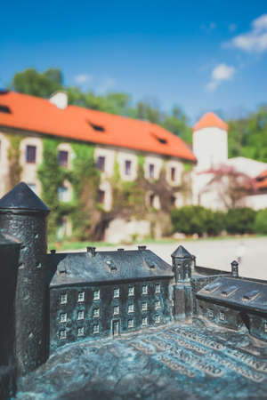 Pieskowa Skala, Poland - May 14, 2017: Model of the Castle in Pieskowa Skala with real buildings in the background, Braille system