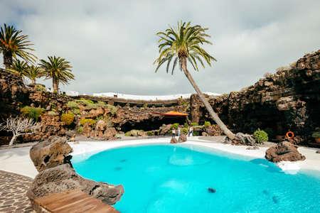 Lanzarote, Spain - March 29, 2017: People visiting volcanic cave in Jameos del Agua, Lanzarote, Canary Islands, Spain Editorial