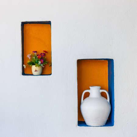 antique vase: Greek style ceramic white vase on white wall background