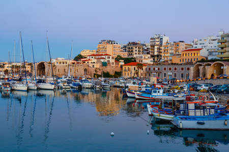 Heraklion, Greece, June 10, 2017: Old harbour of Heraklion with fishing boats and marina during twilight, Crete, Greece