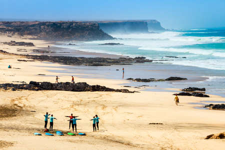 El Cotillo, Fuerteventura, Spain, April 03, 2017: Unknown kitesurfers on a beach in El Cotillo village in Fuerteventura island, Spain