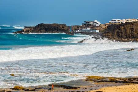 El Cotillo, Fuerteventura, Spain, April 03, 2017: Unknown people on a beach in El Cotillo village in Fuerteventura island, Spain Editorial