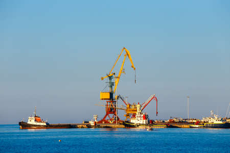 lading: gantry crane in the dock in Heraklion on Crete, Greece