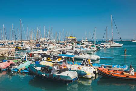 Corralejo, Fuertevetura Island, Spain - April 01, 2017: The skyline of Corralejo with the port and boats in it