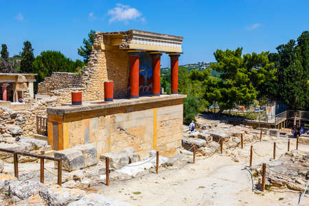 restored: Knossos, Crete, June 10, 2017: Scenic ruins of the Minoan Palace of Knossos. Knossos palace is the largest Bronze Age archaeological site on Crete of the Minoan civilization and culture
