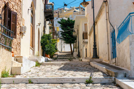 Street with steps in Sitia town, Crete island, Greece Banco de Imagens - 86256184