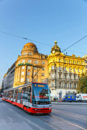 tramway: Prague, Czech Republic, September 29, 2017: Red tram goes on old town in Prague. Pragues major public transport operator is The Capital City of Prague Transport Company, Czech Republic