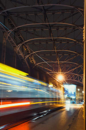 Krakow, Poland, November 12, 2017: Abstract Tram Light Trail on the Pilsudzki bridge in Krakow, Poland