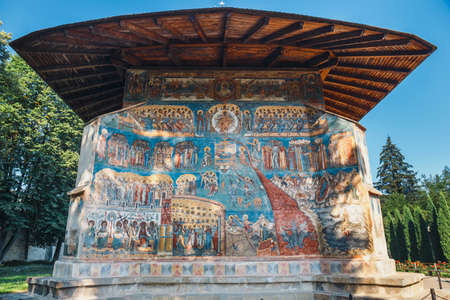 Orthodox church exterior with painted murals, painted church in Romania