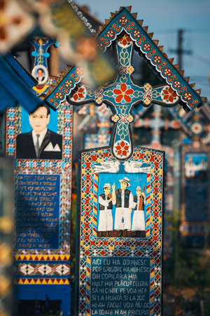 SAPANTA,ROMANIA - 04 JULY, 2015- Carved and painted wooden crosses in the Merry Cemetery in Sapanta, Romania. Those cemetery is unique in Romania and in the world